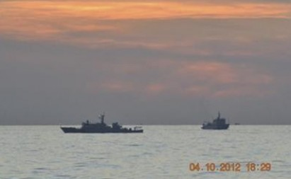 Two Chinese ships can be seen patrolling the disputed waters  in Scarborough or Panatag Shoal in 2012.  File photo courtesy Reuters.