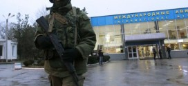 Armed men seize two airports in Ukraine's Crimea, Yanukovich reappears