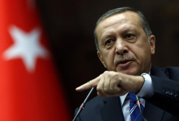 Turkey's Prime Minister Tayyip Erdogan addresses members of parliament from his ruling AK Party (AKP) during a meeting at the Turkish parliament in Ankara April 29, 2014. CREDIT: REUTERS/UMIT BEKTAS