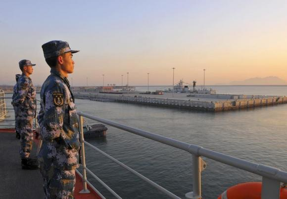 File photo. Chinese naval soldiers stand guard on China's first aircraft carrier Liaoning, as it travels towards a military base in Sanya, Hainan province, in this undated picture made available on November 30, 2013. REUTERS/Stringer
