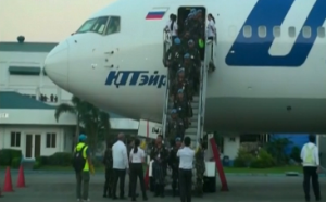 Family members welcome un filipino peacekeepers from liberia for Bureau quarantine philippines