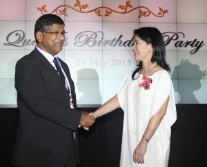 British Ambassador confers the MBE award to Victoria Buenaventura on behalf of Her Majesty Queen Elizabeth II.