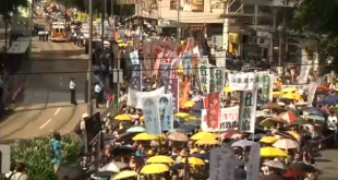 Tens of thousands of protesters take to the streets calling for free elections, and demanding the resignation of Chief Executive Leung Chun-ying.  (Photo grabbed from Reuters video/Courtesy Reuters)