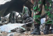 Rescuers continue to remove victims from the site where a military transport plane ploughed into residential area in northern Indonesia, as fears that the death toll could exceed 140 grow. (Courtesy Reuters/Photo grabbed from Reuters video)