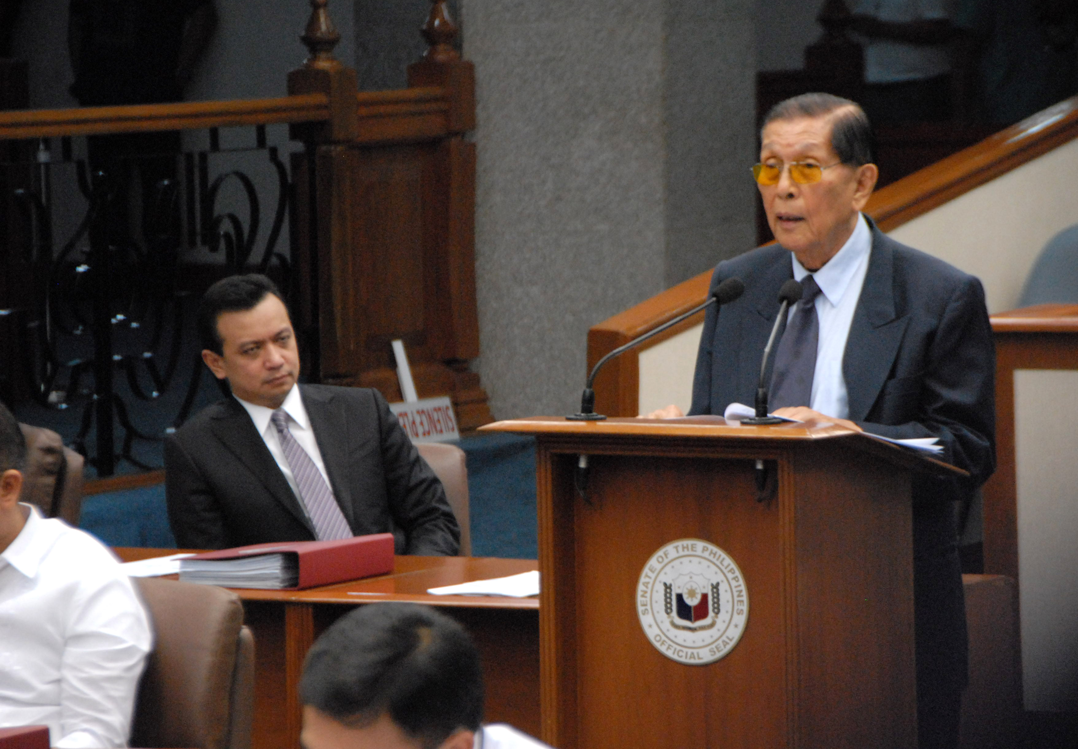 """Minority Floor Leader Juan Ponce Enrile inquires about the status of the committee report on the Mamasapano incident during Wednesday's plenary proceedings. """"It is not only for the courage, the valor, and the sacrifices of the fallen and surviving SAF members in that ghastly and brutal carnage to be placed in the annals of this august Chamber, but also to demonstrate to the general public and to let the people know how their Senate dealt with the complex issues that were discovered and brought to light during the Senate investigation,"""" Enrile said in his privilege speech. (Photo by Joe Arazas / 07 October 2015)"""