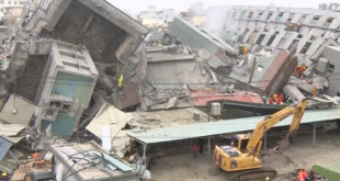 Taiwan rescuers focus on toppled apartment block