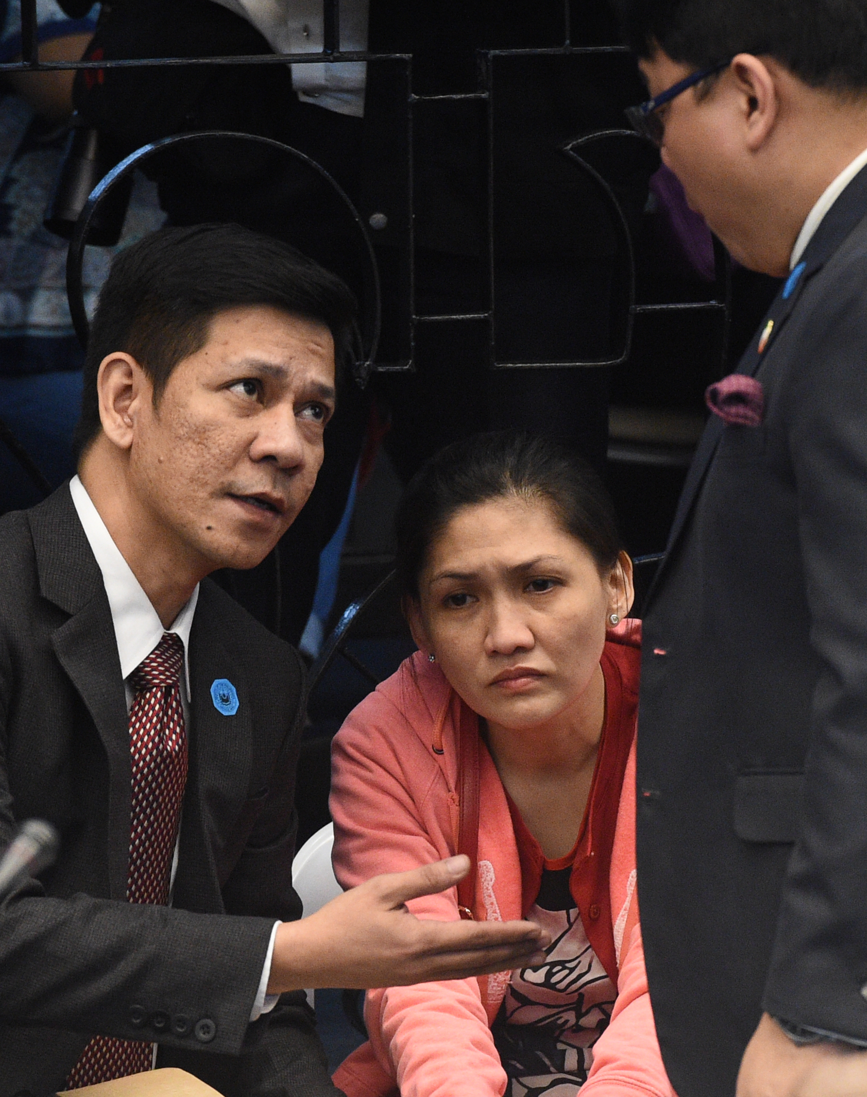 In this photo taken on March 17, 2016  Maia Deguito (C), manager of the Rizal Commercial Banking Corp (RCBC) branch in Manila's financial district, conferes with her lawyers (L/R) at a senate hearing in Manila. When mystery hackers launched a stunning raid on Bangladesh's foreign reserves, a plot worthy of a John le Carre spy novel began in the Philippines exposing the Southeast Asian nation as a dirty money haven. / AFP / TED ALJIBE