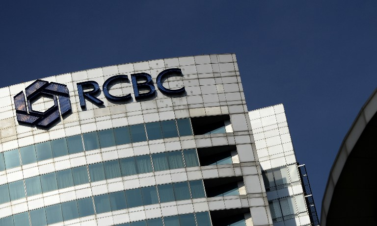 The logo of the RCBC bank is seen at the RCBC building in Manila's financial district on March 11, 2016.   A Philippine bank said it is investigating an 81 million USD deposit after Bangladesh accused Chinese hackers of stealing from a US account and illegally moving the funds online to the Philippines and Sri Lanka. / AFP PHOTO / NOEL CELIS