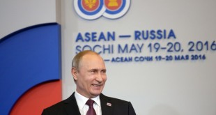 Russian President Vladimir Putin smiles during the welcoming ceremony for heads of the delegations at the Russia-ASEAN summit in Sochi on May 20, 2016.  / AFP PHOTO / Host Photo Agency / -
