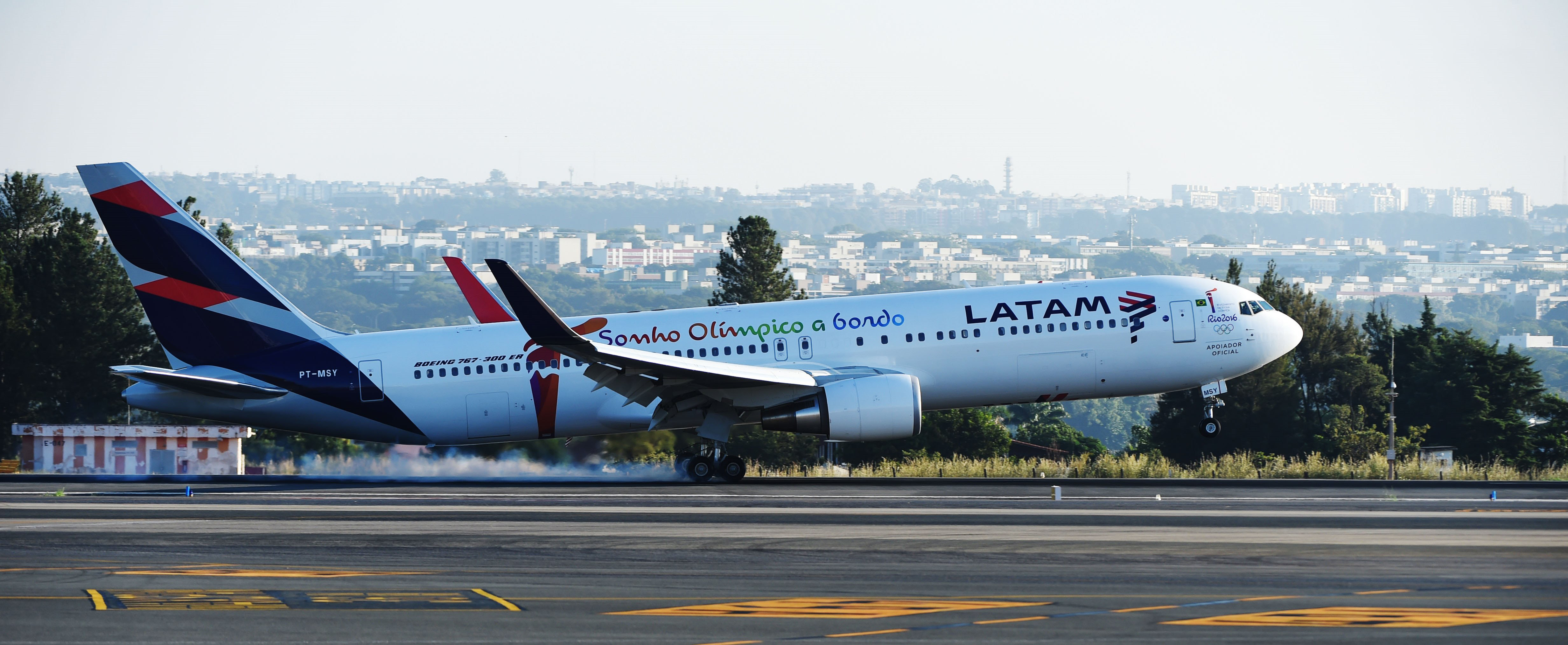 (FILES) This file photo taken on May 3, 2016 shows a LATAM Boeing 767-300ER aircraft transporting the Olympic flame as it arrives in Brasilia from Geneva. Latin America's biggest airline LATAM said on May 30, 2016, it will suspend its flights to crisis-hit Venezuela for an indefinite period, following a similar move by German carrier Lufthansa. / AFP PHOTO / EVARISTO SA