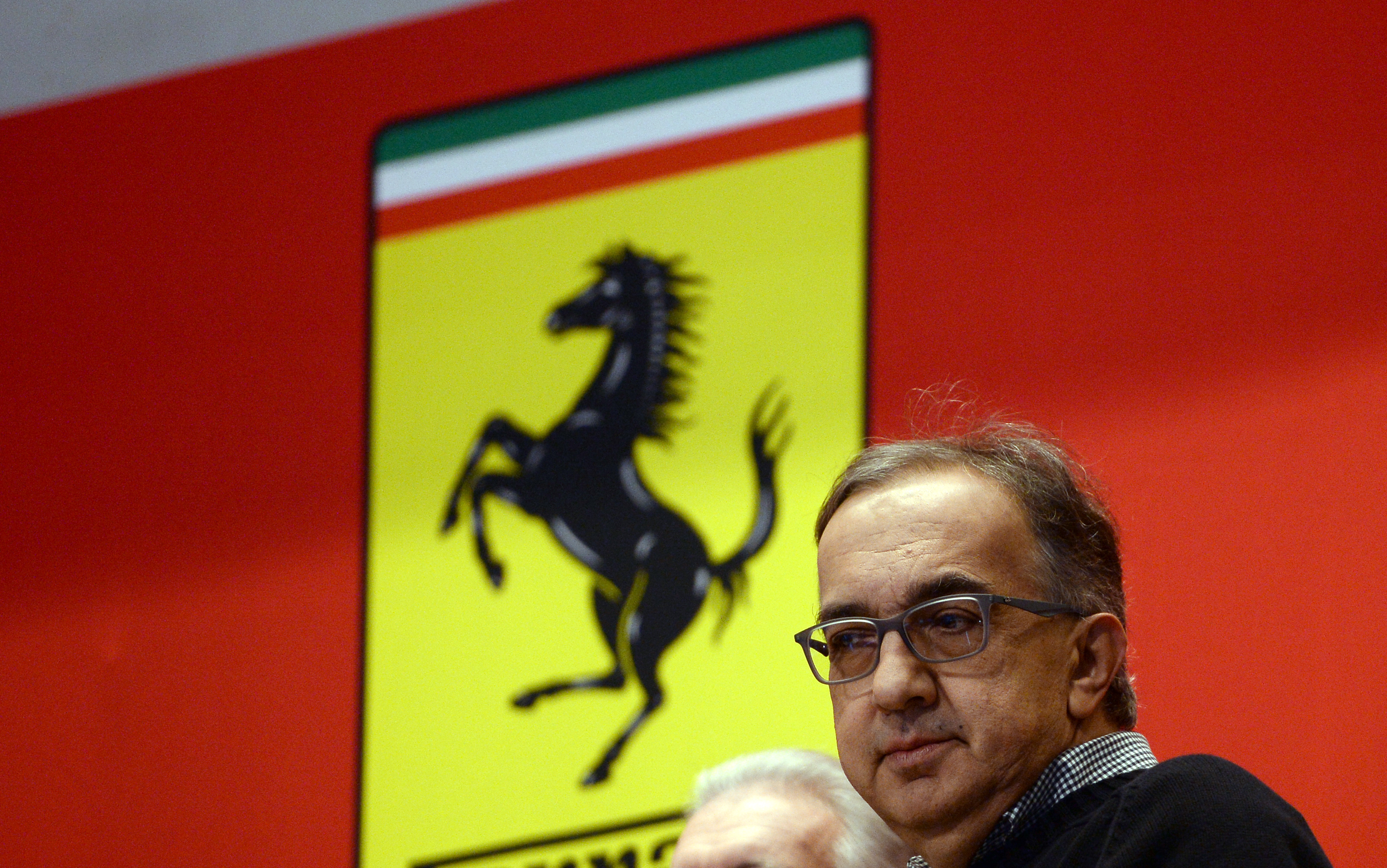Chief Executive Officer of Fiat Chrysler Automobiles Group Sergio Marchionne waits to ring the opening bell at the New York Stock Exchange (NYSE) as Ferrari starts trading for the first day in New York on October 21, 2015. The Dow clung to a modest gain, but the Nasdaq fell early Wednesday as traders weighed big technology deals, mixed earnings and Ferrari's roaring debut on Wall Street. AFP PHOTO/JEWEL SAMAD / AFP PHOTO / JEWEL SAMAD