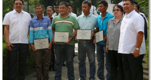 "Agriculture Undersecretary for Operations Atty. Emerson Palad (right), Assistant Secretary for Finance Ophelia Agawin (2nd to the right) and Region IV-B Regional Executive Director Atty. Cipriano Santiago (left) award certificates of recognition to the outstanding farmers and fisherfolk who were recognized during the program for the Farmers' and Fisherfolk's Month held at the Department of Agriculture in Quezon City. Awarded during the event were Fidel Josue for fishery, Demetrio de Ocampo for high value crops, Jerry Villanada for rice, and Leon Bonilla for corn. The month of May was declared as ""Farmers' and Fisherfolk's Month through Proclamation Decree No. 33 signed in 1989 by then President Corazon C. Aquino. The celebration aims to give due recognition and tribute for the major role farmers and fishers play in the overall economic and food sufficiency position of the country.  (photo by Ardy Tompong)"