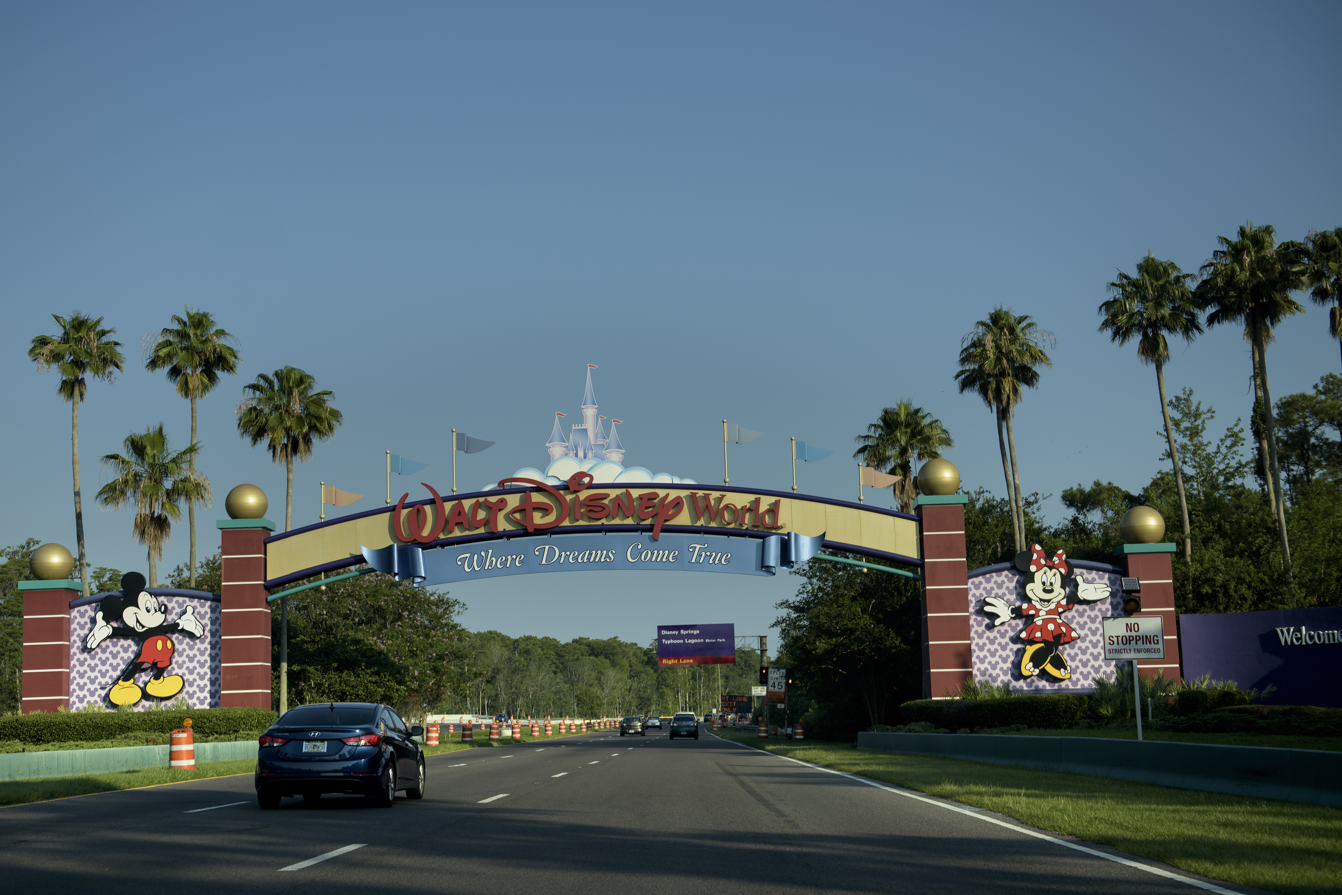 The entrance to the Walt Disney World theme park is seen June 15, 2016 in Orlando, Florida where a two-year-old boy was attacked by an alligator at the Seven Seas Lagoon by the Grand Floridian hotel. An American family's Disney vacation turned into a nightmare when an alligator snatched a two-year-old boy at the shore of a resort lake and fought off the father's frantic attempts to wrest the toddler from its mouth, officials said Wednesday. A search and rescue operation was launched after the attack Tuesday night at the Grand Floridian hotel not far from the Magic Kingdom was ongoing, but police said they held out little hope the boy would be found alive.  / AFP PHOTO / Brendan Smialowski