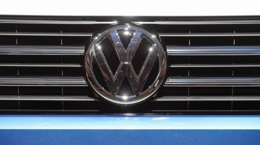 A Volkswagen logo is seen on a VW Multivan on display during German carmaker Volkswagen shareholders' annual general meeting on June 22, 2016 in Hanover.  The boss of embattled German auto giant Volkswagen issued an apology to angry shareholders over the emissions cheating scandal that has plunged the group into an unprecedented crisis. / AFP PHOTO / John MACDOUGALL