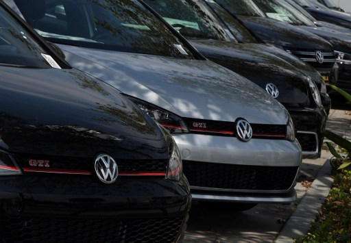Volkswagen cars at a dealership in Los Angeles, California on June 28, 2016.  Volkswagen has agreed to pay out $14.7 billion in a settlement with US authorities and car owners over its emissions-cheating diesel-powered cars. The settlement filed in federal court calls for the German auto giant to either buy back or fix the cars that tricked pollution tests, and to pay each owner up to $10,000 in cash.  / AFP PHOTO / Mark Ralston
