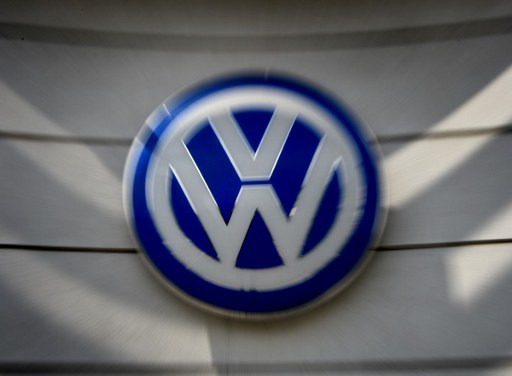 Volkswagen logos at a dealership in Los Angeles, California on June 28, 2016.  Volkswagen has agreed to pay out $14.7 billion in a settlement with US authorities and car owners over its emissions-cheating diesel-powered cars. The settlement filed in federal court calls for the German auto giant to either buy back or fix the cars that tricked pollution tests, and to pay each owner up to $10,000 in cash.  / AFP PHOTO / Mark Ralston