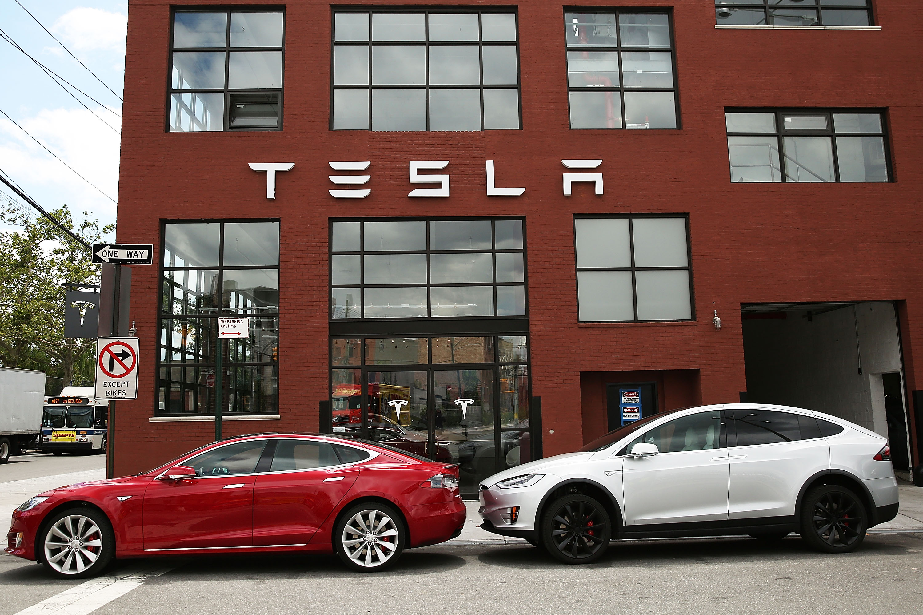NEW YORK, NY - JULY 05: Tesla vehicles sit parked outside of a new Tesla showroom and service center in Red Hook, Brooklyn on July 5, 2016 in New York City. The electric car company and its CEO and founder Elon Musk have come under increasing scrutiny following a crash of one of its electric cars while using the controversial autopilot service. Joshua Brown crashed and died in Florida on May 7 in a Tesla car that was operating on autopilot, which means that Brown's hands were not on the steering wheel.   Spencer Platt/Getty Images/AFP
