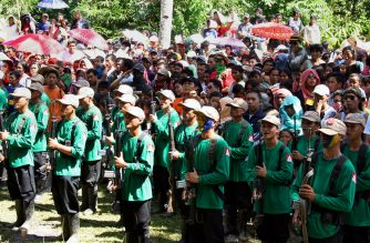 In this file photograph taken on December 26, 2010, New People's Army (NPA) guerrillas attend a ceremony to celebrate the 42nd founding anniversary of the Communist Party of the Philippines, at a remote village in the southern island of Mindanao.   The Philippine government and communist guerrillas have agreed to ceasefires from August 20, both sides said, ahead of crucial peace talks next week to end one of Asia's longest insurgencies. / AFP PHOTO / STRINGER / XGTY