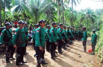 In this file photograph taken on December 26, 2009, New People's Army (NPA) rebels stand to attention during the 41st founding anniversary of the Communist Party of the Philippines at an unspecified location in the hinterlands of Surigao del Sur province, in the southern Philippine island of Mindanao. / AFP PHOTO / MITCHELL MADURO / XGTY