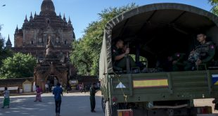 Myanmar military staff sit in a truck outside the damaged ancient Htilominlo Temple on August 25, 2016, after a 6.8 magnitude earthquake hit Bagan. A powerful 6.8 magnitude earthquake struck central Myanmar on August 24, killing at least three people and damaging nearly 200 pagodas in the famous ancient capital of Bagan, officials said. The quake, which the US Geological Survey said hit at a depth of 84 kilometres (52 miles), was also felt across neighbouring Thailand, India and Bangladesh, sending panicked residents rushing onto the streets.  / AFP PHOTO / YE AUNG THU