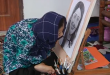 A disabled Afghan girl who draws life-like sketches with her mouth hopes to have a career as an artist and have international exhibitions.(photo grabbed from Reuters video)