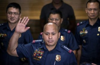 (File photo) Philippine National Police (PNP) chief director general Ronald Dela Rosa (front) gestures as he speaks during a press conference at PNP headquarters in Manila on July 6, 2016. / AFP PHOTO / NOEL CELIS