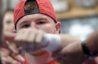 SAN DIEGO, CA - AUGUST 31: Boxer Canelo Alvarez of Mexico has his hands taped up during his Open Workout at the House of Boxing on August 31, 2016 in San Diego, California. Canelo Alvarez fights Liam Smith of Great Britain for the WBO Junior Middleweight World Championship on September 17, 2016 in Arlington, Texas.   Donald Miralle/Getty Images/AFP