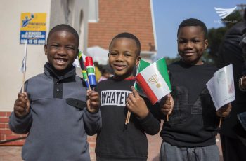These South African children who are members of the Iglesia Ni Cristo (Church of Christ) are all smiles as they waved flaglets during the dedication of the new INC house of worship in Cape Town, South Africa on August 27, 2016.  INC Executive Minister Brother Eduardo V. Manalo recently dedicated two houses of worship in South Africa.  First was in Johannesburg on August 20, and the second was in Cape Town on August 27.  (Photo courtesy: INC Executive News)