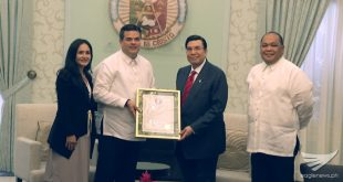 Senator Rory Respicio, majority leader of Guam's 33rd Legislature, presents to Iglesia Ni Cristo Executive Minister Brother Eduardo V. Manalo, a framed copy of Resolution 419-33 (COR) of Guam's legislative body that pays tribute to the INC and its contributions to Guam and throughout the world.  The resolution also congratulated the INC, on behalf of the people of Guam, on its 102nd anniversary this July 27.   (Eagle News Service)