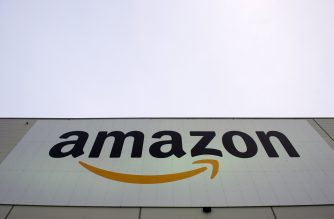 The logo of US online retail giant Amazon is displayed on the Brieselang logistics center, west of Berlin on November 11, 2014. The center is one of nine in Germany. AFP PHOTO / JOHN MACDOUGALL / AFP PHOTO / JOHN MACDOUGALL