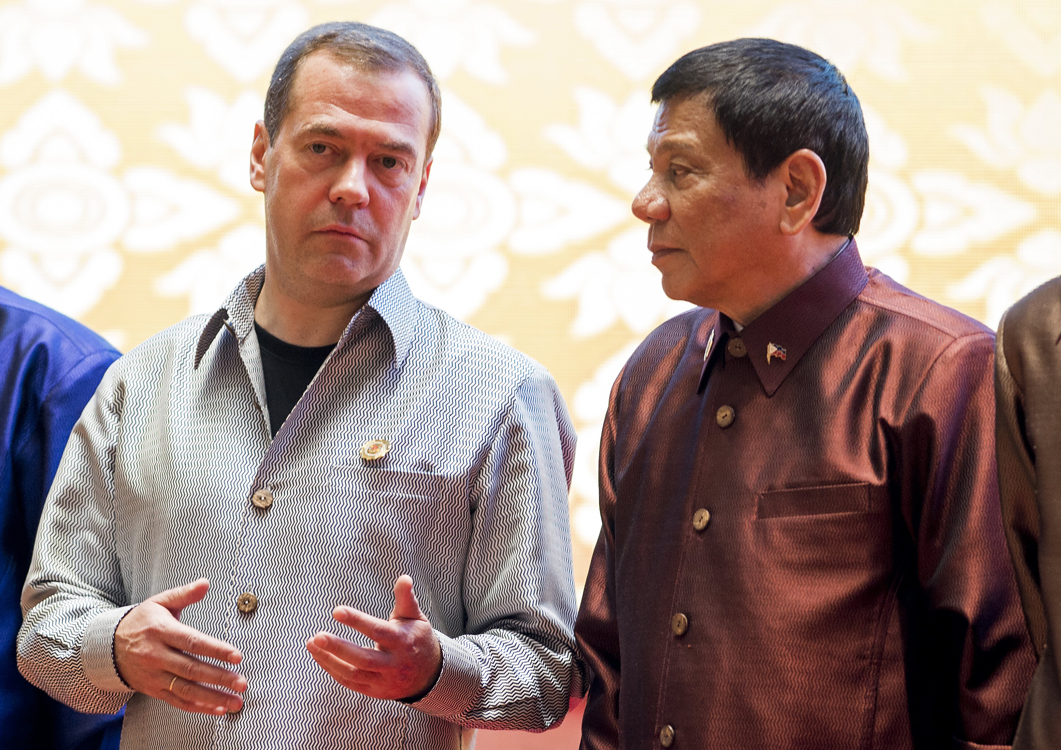 Russian Prime Minister Dmitry Medvedev (L) chats with Philippine President Rodrigo Duterte as they attend the gala dinner during the second day of the Association of Southeast Asian Nations (ASEAN) Summit in Vientiane on September 7, 2016. The gathering will see the 10 ASEAN members meet by themselves, then with leaders from the US, Japan, South Korea and China. / AFP PHOTO / YE AUNG THU