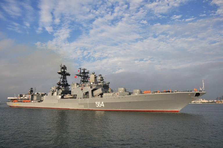 This picture taken on September 12, 2016 shows the Russian destroyer Admiral Tributs arriving at Zhanjiang port in China's southern Guangdong province. Russian navy ships arrived for eight-day joint military exercises with the Chinese navy in the South China Sea, in a show of force after an international tribunal invalidated the Asian giant's extensive claims in the region. / AFP PHOTO / STR / China OUT