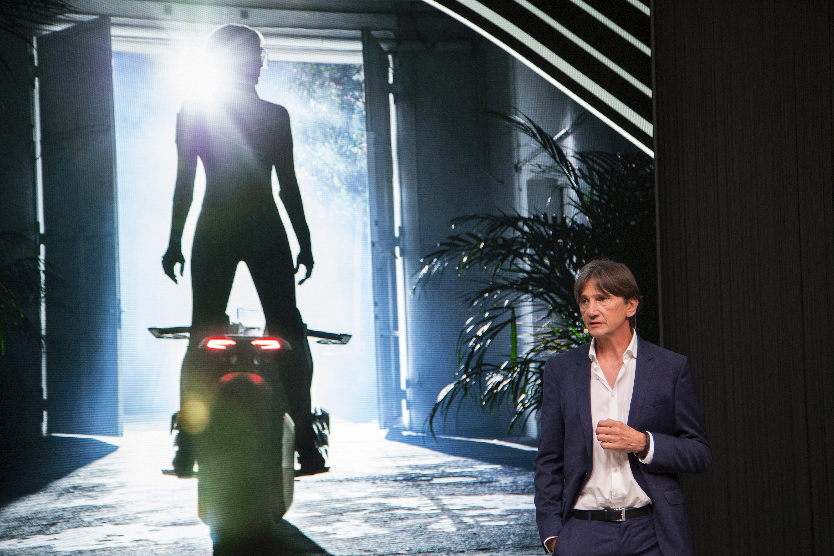 Head of BMW Motorrad Design, Edgar Heinrich speaks at the unveiling of the BMW Motorrad VISION NEXT 100 concept motorcycle at the last of four international stops of the Iconic Impulses event, recognizing 100 years of BMW, on October 11, 2016 in Santa Monica, California. / AFP PHOTO / DAVID MCNEW