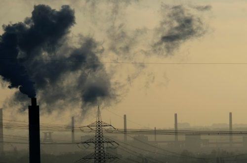 (FILES) This file photo taken on December 29, 2014 shows steam rises from a coke producing plant in Bottrop, western Germany.  The air has never been as polluted by carbon dioxide (CO2), the main greenhouse gas, as in 2015, with an average concentration of 400 ppm (parts per million) in the atmosphere, a symbolic threshold record, according to a report by the World Meteorological Organization (WMO) issued on October 24, 2016. The report was released before the negotiations on climate change, to be held in Marrakech (Morocco) from November 7 to 18, 2016. / AFP PHOTO / PATRIK STOLLARZ