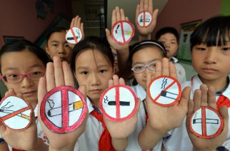 This photo taken on May 30, 2016 shows students wearing masks with no smoking signs to support World No Tobacco Day at a primary school in Handan, northern China's Hebei province.  The slumping output of tobacco products in China has become one of the factors in the country's lowest industrial production rate since the global financial crisis during the first two months of the year. / AFP PHOTO / STR / China OUT