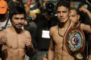 Boxers Manny Pacquiao, Philippines, and Jessie Vargas, USA, pose together during their official weigh-in at the Wynn Las Vegas hotel in Las Vegas, Nevada on November 4, 2016.   Pacquiao will challenge Vargas for the WBO Welterweight Title Saturday, November 5, 2016 at the Thomas & Mack Center.  / AFP PHOTO / John GURZINSKI