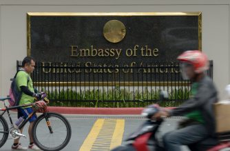 Commuters pass in front of the highly-secured US embassy in Manila on July 6, 2013. The United States issued a warning against travel to the southern Philippines, the embassy said, just days after Australia and Canada issued a similar advisory to their citizens, citing threats from criminal gangs and terrorist groups in the south, but not specifying any threat.   AFP PHOTO / Jay DIRECTO / AFP PHOTO / JAY DIRECTO