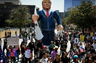(FILES) This file photo taken on May 01, 2016 shows Members of the 'Full Rights for Immigrants Coalition'  displaying  a giant effigy of US Republican Party presidential hopeful Donald Trump during a protest on May Day in Los Angeles, California on May 1, 2016.  State officials, religious leaders and rights groups in California are struggling to reassure immigrants after the election of Donald Trump, urging unity and vowing support but also bracing for the worst. / AFP PHOTO / GETTY IMAGES NORTH AMERICA / Mark Ralston