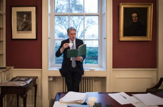 British Chancellor of the Exchequer Philip Hammond is pictured looking at his Autumn Statement in his office at 11 Downing Street in central London on November 22, 2016. Britain on Wednesday delivers its first budget since the Brexit referendum, with economists expecting a slight shift away from years of austerity as the nation readies its EU exit strategy. The Conservative government's finance minister Philip Hammond will deliver his so-called Autumn Statement before parliament around 1230 GMT Wednesday -- exactly five months after the Brexit vote. / AFP PHOTO / POOL / Stefan Rousseau