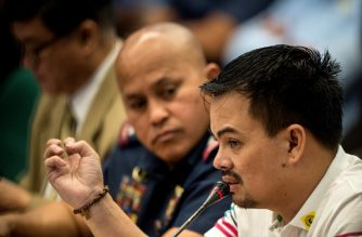 Kerwin Espinosa (R), son of the late mayor Rolando Espinosa, gestures as he answers the Senators' question during the Senate drug hearing at the Senate building in Manila on November 23, 2016.  Kerwin was arrested in the United Arab Emirates last month and will face drug trafficking charges.  / AFP PHOTO / NOEL CELIS