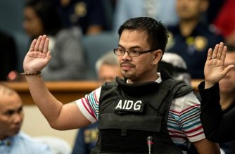 Kerwin Espinosa, son of the late mayor Rolando Espinosa, takes an oath during the Senate drug hearing at the Senate building in Manila on November 23, 2016.  Kerwin was arrested in the United Arab Emirates last month and will face drug trafficking charges.  / AFP PHOTO / NOEL CELIS