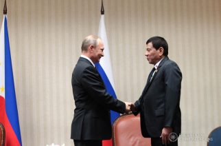 Russian Federation President Vladimir Putin is seen in this photo smiling as he and Philippine President Rodrigo Duterte shake hands during their bilateral meeting at the sidelines of the APEC Leaders' Summit in Lima, Peru in November 2016.  (Presidential Communications photo)