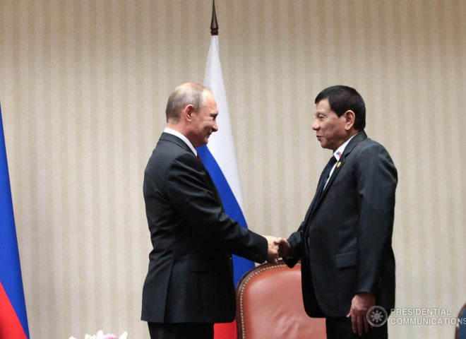 News in photo:  A rare photo of a smiling President Putin as he greets Philippines' Duterte
