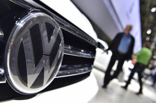 A Volkswagen logo is seen on a VW Tiguan on display during German carmaker Volkswagen shareholders' annual general meeting on June 22, 2016 in Hanover.  The boss of embattled German auto giant Volkswagen issued an apology to angry shareholders over the emissions cheating scandal that has plunged the group into an unprecedented crisis. / AFP PHOTO / JOHN MACDOUGALL
