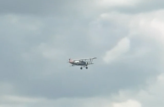 Biplane flying over spectators. (Photo courtesy of Reuters video file)