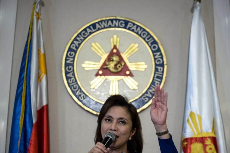 Philippines' Vice-President Leni Robredo gestures during a press conference in Manila on December 5, 2016.  Robredo vowed on December 5 to spearhead national opposition against extrajudicial killings and other flashpoint issues surrounding firebrand leader Rodrigo Duterte's controversial anti-crime crackdown. / AFP PHOTO / Noel CELIS
