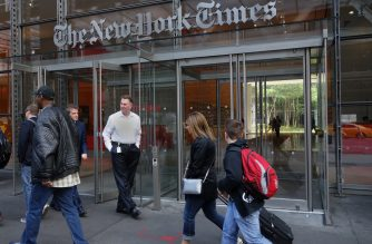 (FILES) This file photo taken on April 27, 2016 shows  people walking past the west entrance of the New York Times building at 620 Eighth Avenue in New York. The New York Times has seen an exceptional surge in digital subscriptions in the period just before and after the November election, its top executive said December 5, 2016. New York Times Co. chief executive Mark Thompson told a business conference the prestigious daily has added more than 200,000 net subscribers since late September.  / AFP PHOTO / DON EMMERT
