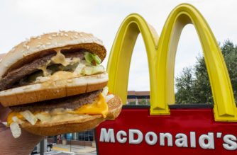 (FILES) This file photo taken on August 10, 2015 shows a McDonald's Big Mac held up near the golden arches at a McDonalds's in Centreville, Virginia.      McDonald's said December 8, 2016 it will shift its fiscal headquarters for the majority of non-US operations to Britain following an EU crackdown on the fast-food giant's tax benefits from Luxembourg. McDonald's is establishing a new Britain-based holding company to cover royalties from most licensing agreements outside the United States. The profits will be subject to British corporate taxes, McDonald's said.  / AFP PHOTO / PAUL J. RICHARDS