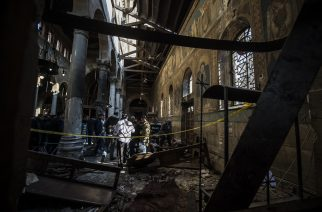 Egyptian security forces inspect the scene of a bomb explosion at the Saint Peter and Saint Paul Coptic Orthodox Church on December 11, 2016, in Cairo's Abbasiya neighbourhood. The blast killed at least 25 worshippers during Sunday mass inside the Cairo church near the seat of the Coptic pope who heads Egypt's Christian minority, state media said. / AFP PHOTO / KHALED DESOUKI