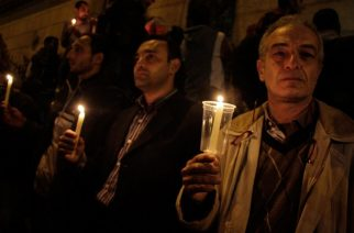 Egyptians carry candles during a vigil for the victims of a bomb explosion that targeted the Saint Peter and Saint Paul Coptic Orthodox Church on December 11, 2016, outside the Church in Cairo's Abbasiya neighbourhood. The blast killed at least 25 worshippers during Sunday mass inside the Cairo church near the seat of the Coptic pope who heads Egypt's Christian minority, state media said. / AFP PHOTO / SUHAIL SALEH